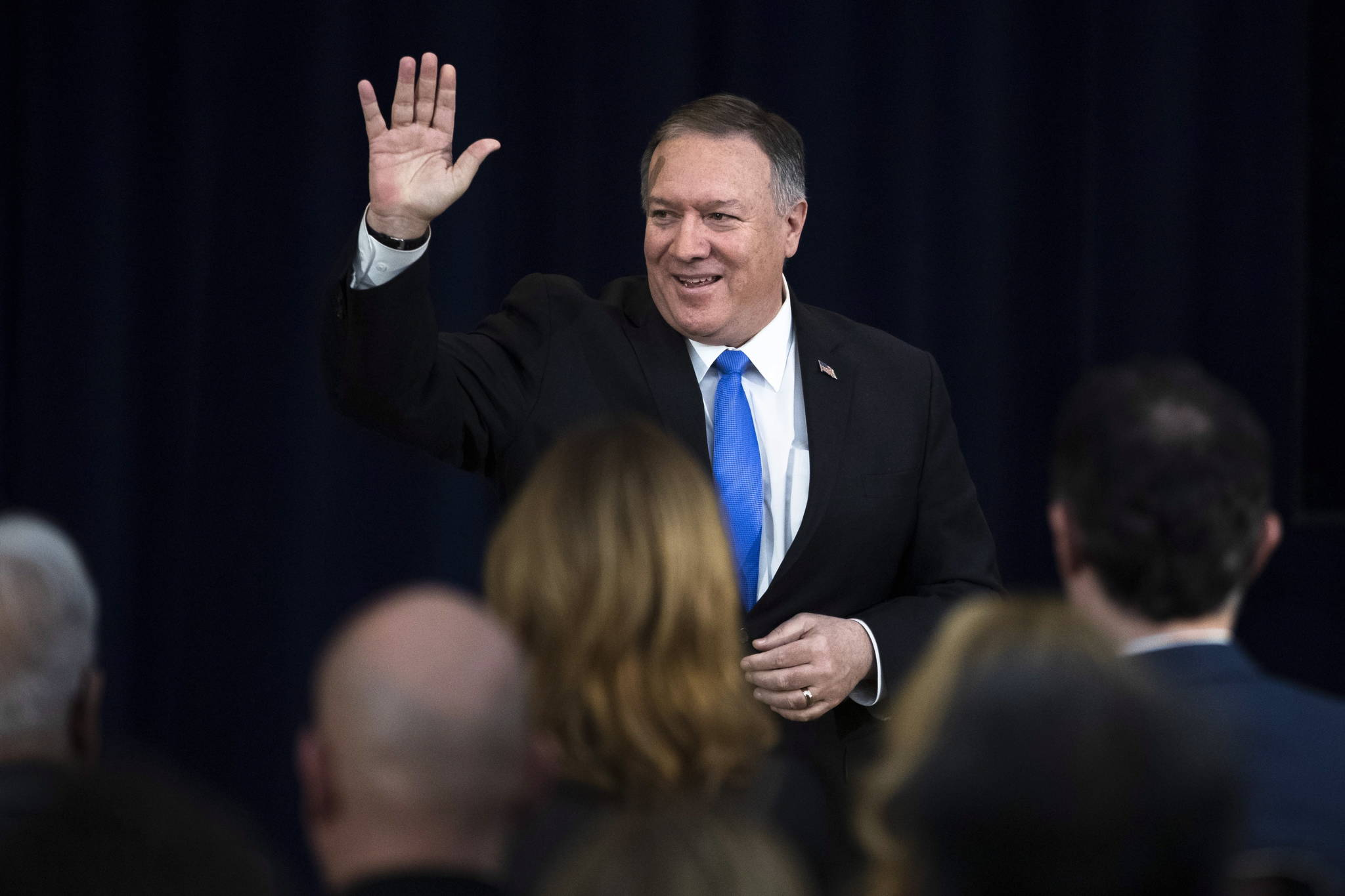 """Secretary of State Mike Pompeo departs an event at the State Department in Washington on December 19, 2019. U.S. Secretary of State Mike Pompeo says his country is sticking with Canada in fighting what he calls China's """"coercive detentions of Canadian citizens."""" Pompeo and Foreign Affairs Minister Francois-Philippe Champagne say they talked Monday about a range of global concerns. THE CANADIAN PRESS/AP, Matt Rourke"""